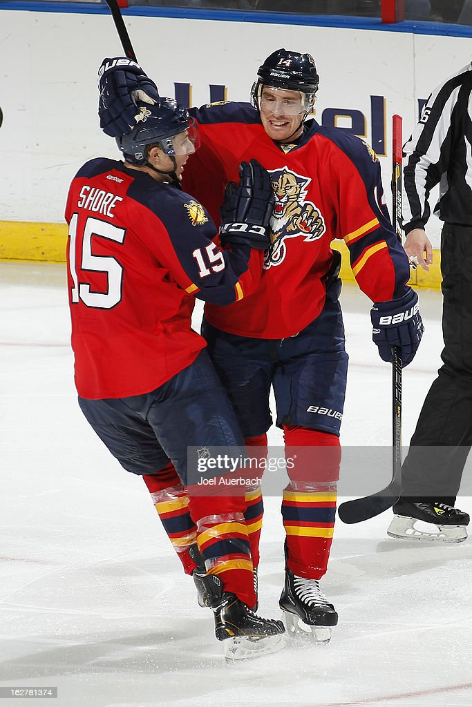 <a gi-track='captionPersonalityLinkClicked' href=/galleries/search?phrase=Tomas+Fleischmann&family=editorial&specificpeople=554398 ng-click='$event.stopPropagation()'>Tomas Fleischmann</a> #14 is congratulated by Drew Shore #15 of the Florida Panthers after he scored his 100th goal in the NHL in the game against the Pittsburgh Penguins at the BB&T Center on February 26, 2013 in Sunrise, Florida. The Panthers defeated the Penguins 6-4.