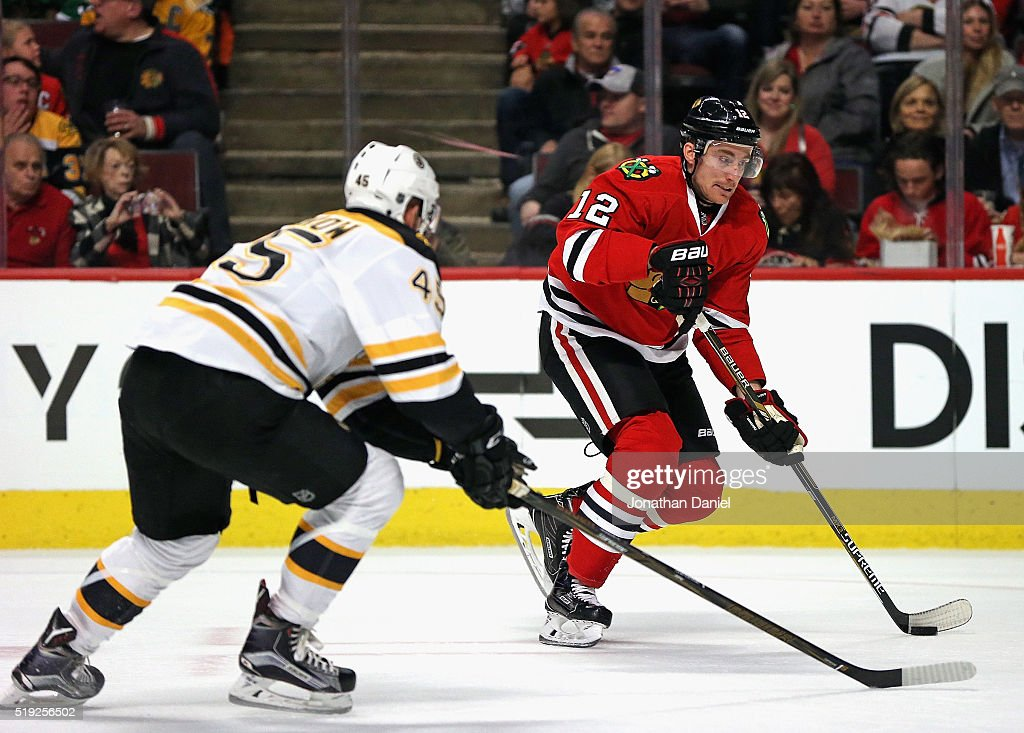 Tomas Fleischmann of the Chicago Blackhawks controls the puck against Joe Morrow of the Boston Bruins at the United Center on April 3 2016 in Chicago...
