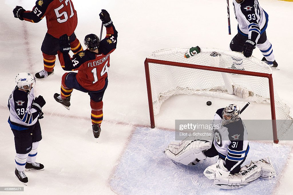Tomas Fleischmann #14 of the Florida Panthers celebrates his goal against Goaltender Ondrej Pavelec #31 of the Winnipeg Jets at the BB&T Center on December 5, 2013 in Sunrise, Florida.