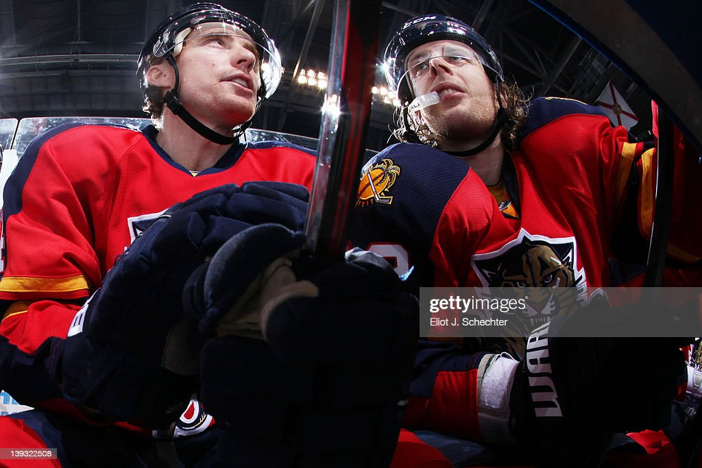 Tomas Fleischmann #14 of the Florida Panthers chats with teammate Kris Versteeg #32 in between shifts against the Washington Capitals at the BankAtlantic Center on February 17, 2012 in Sunrise, Florida.