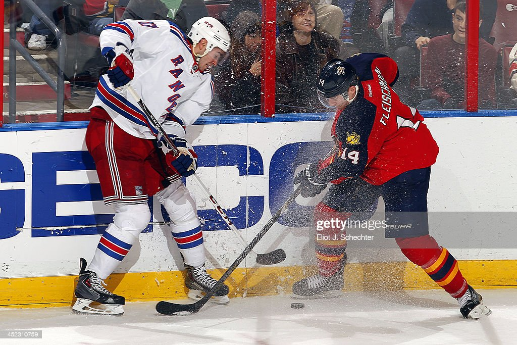 <a gi-track='captionPersonalityLinkClicked' href=/galleries/search?phrase=Tomas+Fleischmann&family=editorial&specificpeople=554398 ng-click='$event.stopPropagation()'>Tomas Fleischmann</a> #14 of the Florida Panthers crosses sticks with John Moore #17 of the New York Rangers at the BB&T Center on November 27, 2013 in Sunrise, Florida.