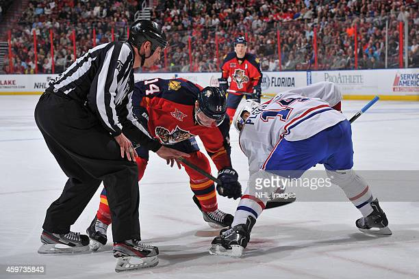 Tomas Fleischmann of the Florida Panthers faces off against Tomas Plekanec of the Montreal Canadiens at the BBT Center on December 29 2013 in Sunrise...