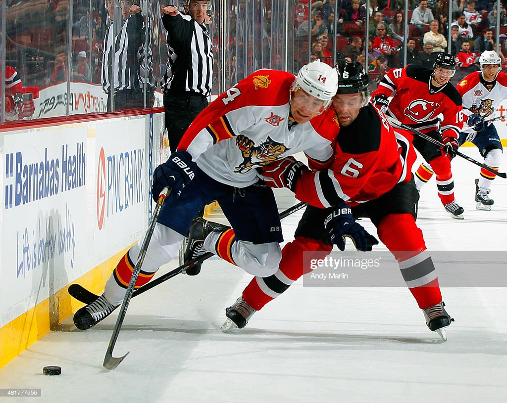 <a gi-track='captionPersonalityLinkClicked' href=/galleries/search?phrase=Tomas+Fleischmann&family=editorial&specificpeople=554398 ng-click='$event.stopPropagation()'>Tomas Fleischmann</a> #14 of the Florida Panthers is checked off the puck by <a gi-track='captionPersonalityLinkClicked' href=/galleries/search?phrase=Andy+Greene&family=editorial&specificpeople=3568726 ng-click='$event.stopPropagation()'>Andy Greene</a> #6 of the New Jersey Devils during the game at the Prudential Center on March 31, 2014 in Newark, New Jersey.