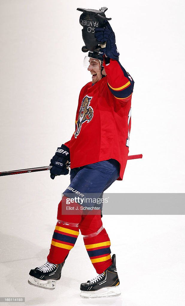 <a gi-track='captionPersonalityLinkClicked' href=/galleries/search?phrase=Tomas+Fleischmann&family=editorial&specificpeople=554398 ng-click='$event.stopPropagation()'>Tomas Fleischmann</a> #14 of the Florida Panthers picks up a giant rubber victory rat after their overtime win against the New Jersey Devils at the BB&T Center on March 30, 2013 in Sunrise, Florida.