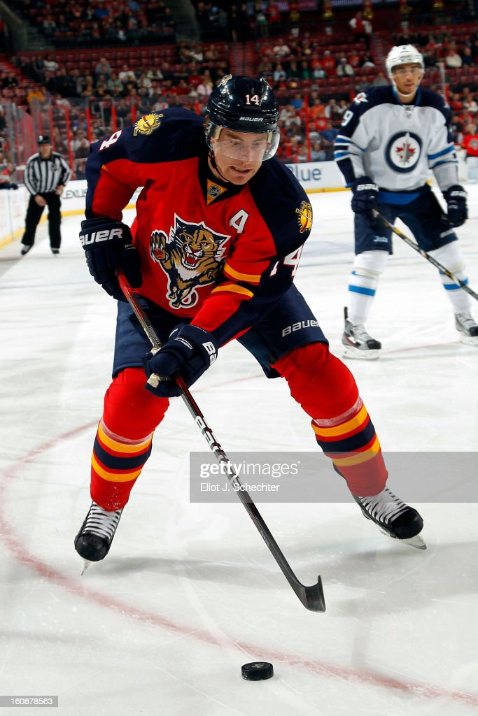 Tomas Fleischmann #14 of the Florida Panthers skates with the puck against the Winnipeg Jets at the BB&T Center on January 31, 2013 in Sunrise, Florida.