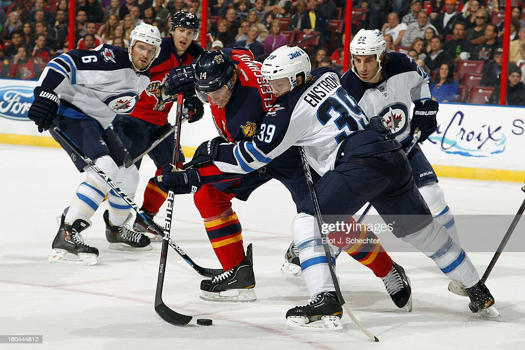 Tomas Fleischmann #14 of the Florida Panthers tangles with Tobias Enstrom #39 of the Winnipeg Jets at the BB&T Center on January 31, 2013 in Sunrise, Florida.