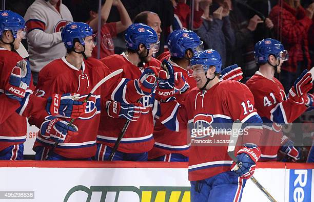 Tomas Fleischmann of the Montreal Canadiens celebrates with the bench after scoring a goal against the Winnipeg Jets in the NHL game at the Bell...