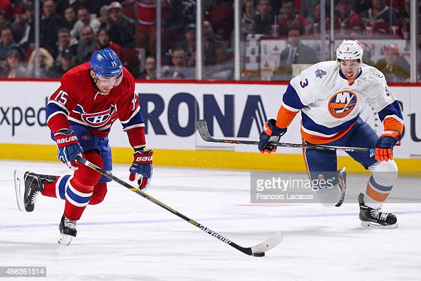 Tomas Fleischmann of the Montreal Canadiens skates with the puck in the NHL game against the New York Islanders at the Bell Centre on November 22...