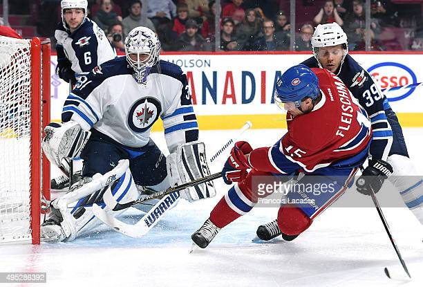 Tomas Fleischmann of the Montreal Canadiens takes a shot on Michael Hutchinson of the Winnipeg Jets in the NHL game at the Bell Centre on November 1...
