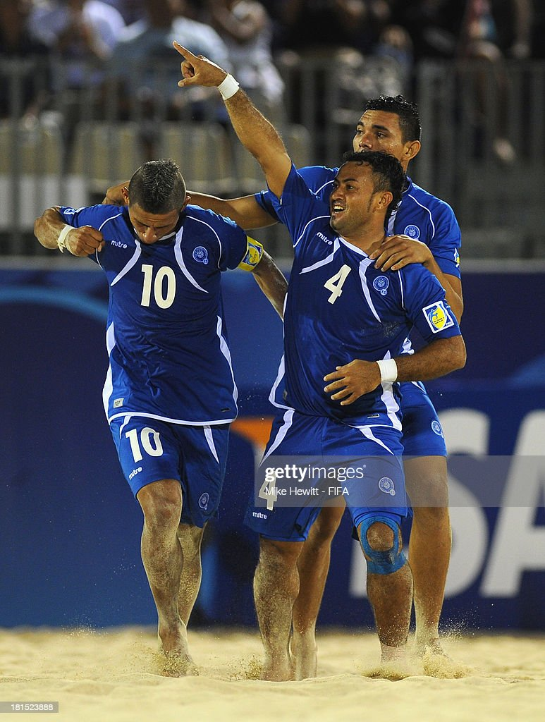 Tomas Hernandez (4) of El Salvador celebrates with Augustin Ruiz after scoring during the FIFA Beach Soccer World Cup Tahiti 2013 Group B match between El Salvador and Netherlands at the To'ata Stadium on September 21, 2013 in Papeete, French Polynesia.