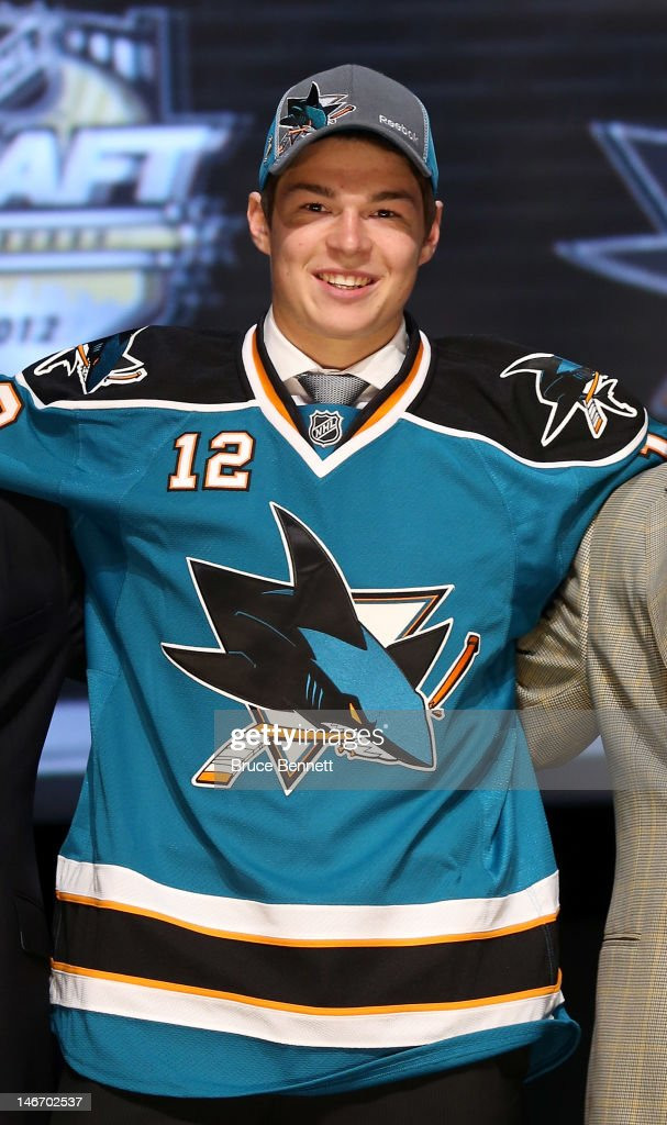 Tomas Hertl, 17th overall pick by the San Jose Sharks, poses on stage during Round One of the 2012 NHL Entry Draft at Consol Energy Center on June 22, 2012 in Pittsburgh, Pennsylvania.