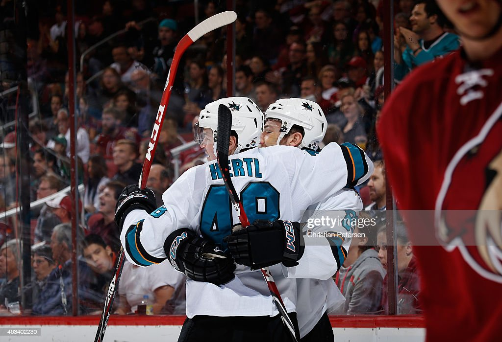 Tomas Hertl #48 and Barclay Goodrow #89 of the San Jose Sharks celebrate after Goodrow scored a third period goal against the Arizona Coyotes during the NHL game at Gila River Arena on February 13, 2015 in Glendale, Arizona. The Sharks defeated the Coyotes 4-2.