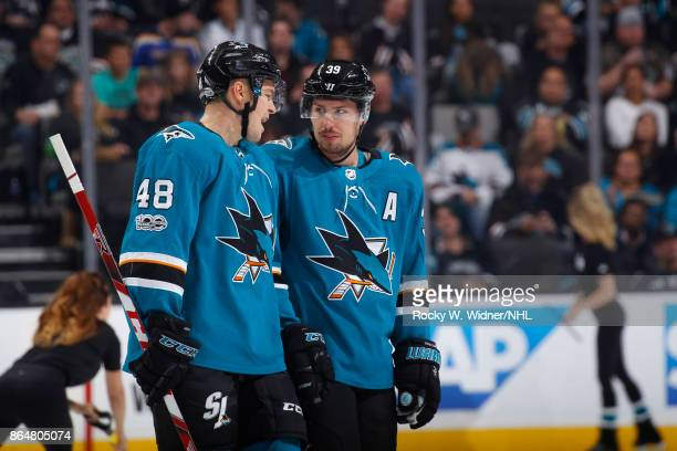 Tomas Hertl and Logan Couture of the San Jose Sharks talk during the game against the New York Islanders at SAP Center on October 14 2017 in San Jose...