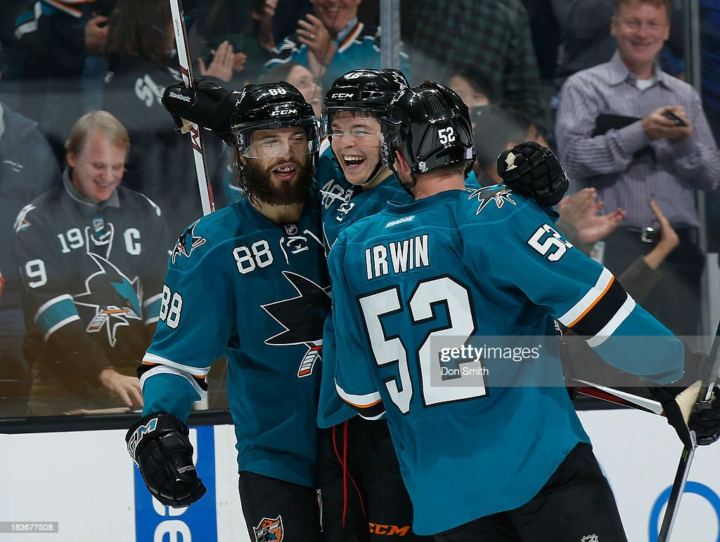 <a gi-track='captionPersonalityLinkClicked' href=/galleries/search?phrase=Tomas+Hertl&family=editorial&specificpeople=8761287 ng-click='$event.stopPropagation()'>Tomas Hertl</a> #48, <a gi-track='captionPersonalityLinkClicked' href=/galleries/search?phrase=Brent+Burns&family=editorial&specificpeople=212883 ng-click='$event.stopPropagation()'>Brent Burns</a> #88 and Matt Irwin #52 of the San Jose Sharks celebrate Hertl's goal against the New York Rangers during an NHL game on October 8, 2013 at SAP Center in San Jose, California.