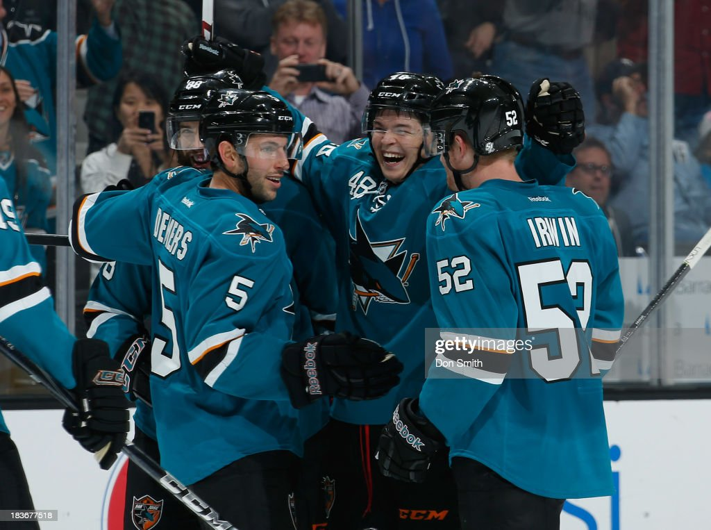 <a gi-track='captionPersonalityLinkClicked' href=/galleries/search?phrase=Tomas+Hertl&family=editorial&specificpeople=8761287 ng-click='$event.stopPropagation()'>Tomas Hertl</a> #48, Matt Irwin #52 and Jason Demers #10 of the San Jose Sharks celebrate Hertl's goal against the New York Rangers during an NHL game on October 8, 2013 at SAP Center in San Jose, California.