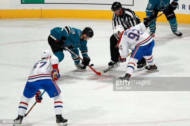 Tomas Hertl of the San Jose Sharks and Jonathan Drouin of the Montreal Canadiens faceoff as Max Pacioretty of the Montreal Canadiens looks at SAP...