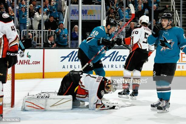 Tomas Hertl of the San Jose Sharks and Reto Berra of the Anaheim Ducks react after Joonas Donskoi of the San Jose Sharks scores a third period goal...