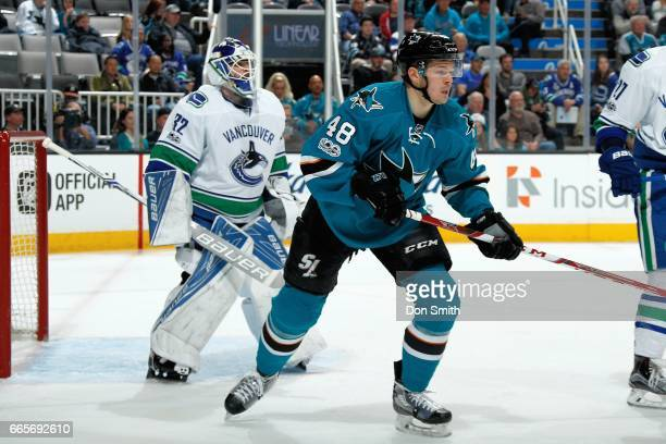 Tomas Hertl of the San Jose Sharks and Richard Bachman of the Vancouver Canucks look during a NHL game at SAP Center at San Jose on April 4 2017 in...