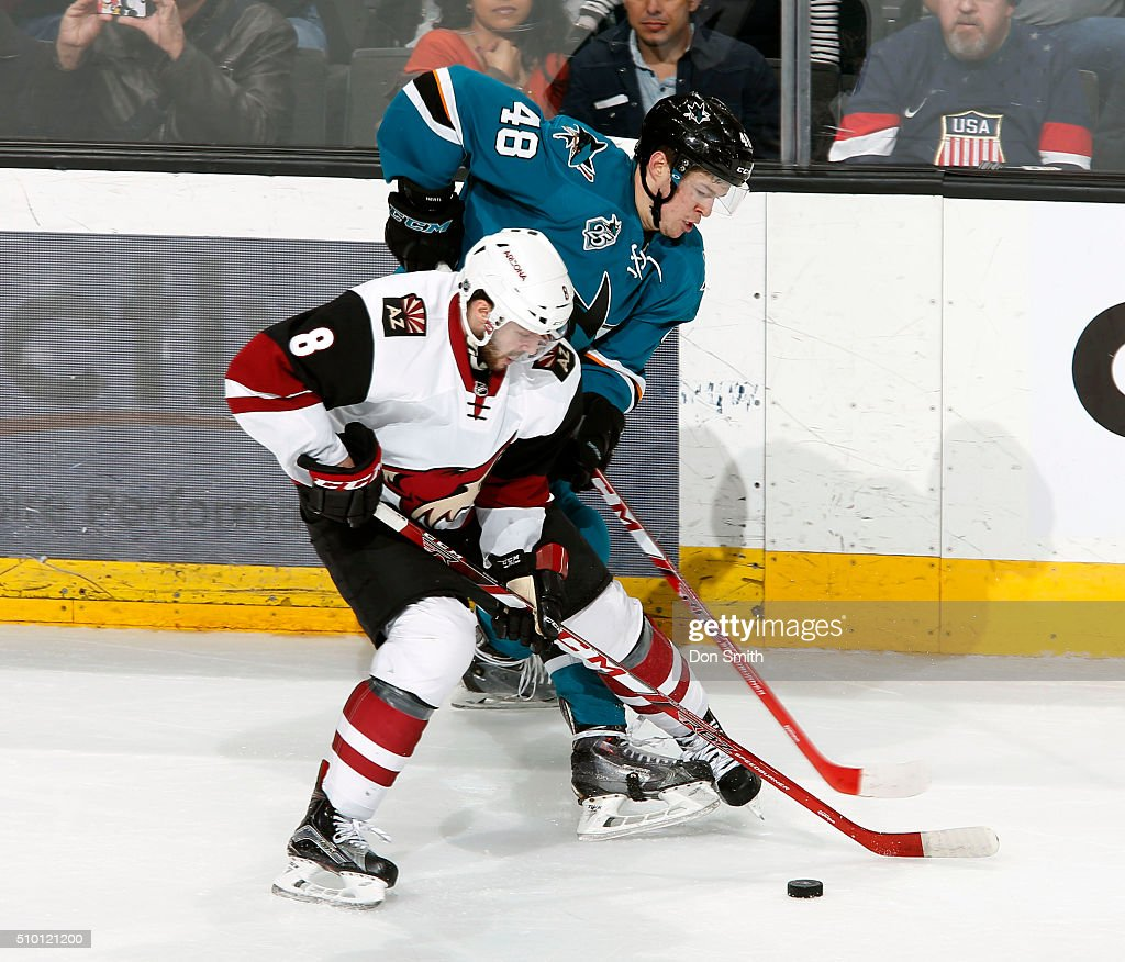 Tomas Hertl #48 of the San Jose Sharks battles for puck against Tobias Rieder #8 of the Arizona Coyotes during a NHL game at the SAP Center at San Jose on February 13, 2016 in San Jose, California.