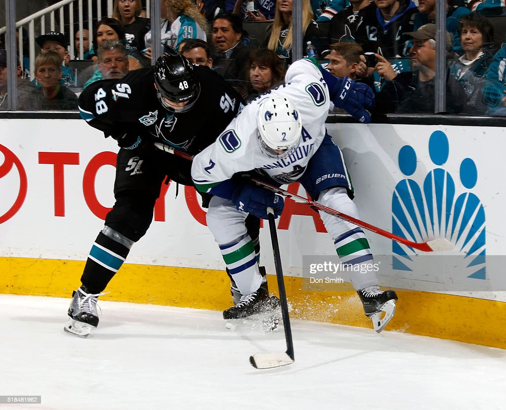 Tomas Hertl #48 of the San Jose Sharks battles for the puck along the boards against Dan Hamhuis #2 of the Vancouver Canucks during a NHL game at the SAP Center at San Jose on March 31, 2016 in San Jose, California.