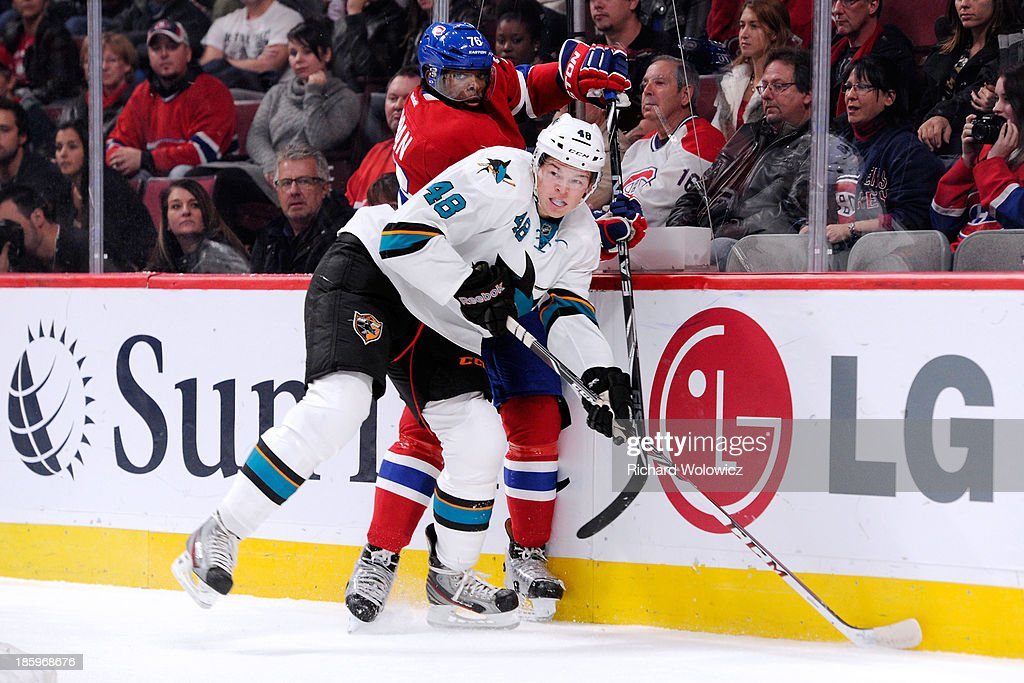 Tomas Hertl #48 of the San Jose Sharks body checks P.K. Subban #76 of the Montreal Canadiens during the NHL game at the Bell Centre on October 26, 2013 in Montreal, Quebec, Canada.