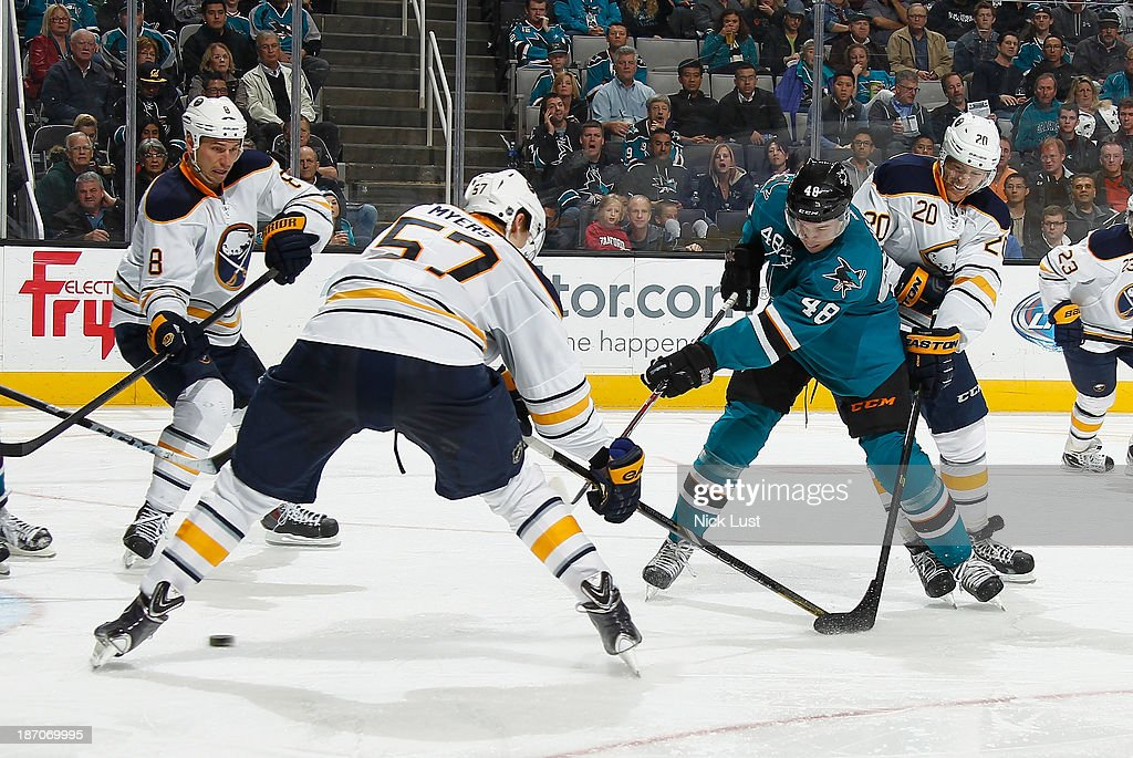 Tomas Hertl #48 of the San Jose Sharks gets a shot on goal against Tyler Myers #57, Henrik Tallinder #20 and Cody McCormick #8 of the Buffalo Sabres during an NHL game on November 5, 2013 at SAP Center in San Jose, California.