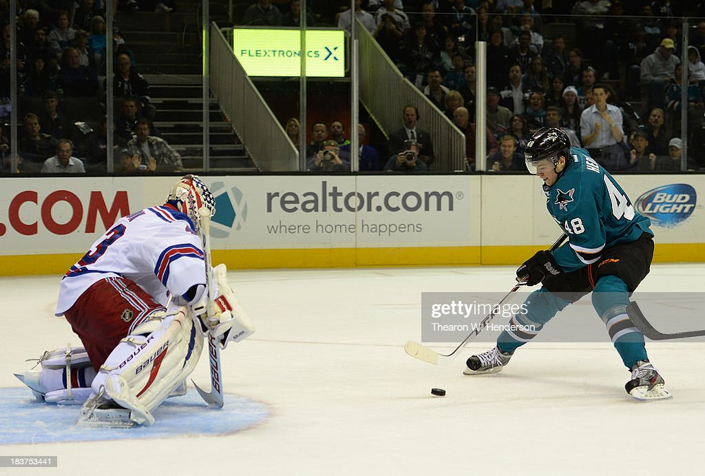 Tomas Hertl #48 of the San Jose Sharks gets his shot past goalkeeper Martin Biron #43 of the New York Rangers scoring his second goal of the second period at SAP Center on October 8, 2013 in San Jose, California.