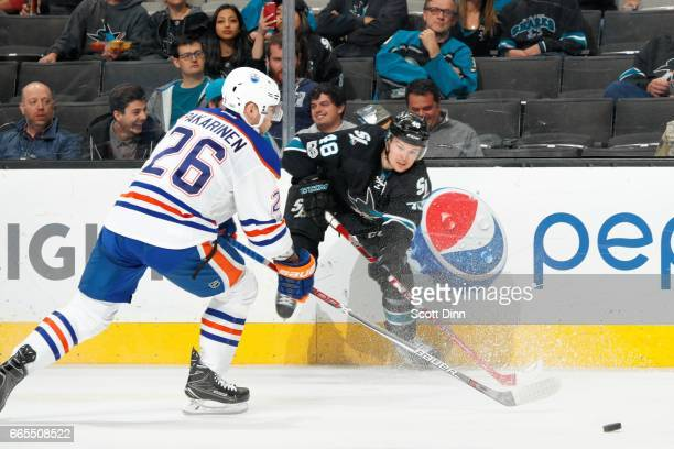 Tomas Hertl of the San Jose Sharks gets the puck by Liro Pakarinen of the Edmonton Oilers during a NHL game at SAP Center at San Jose on April 6 2017...