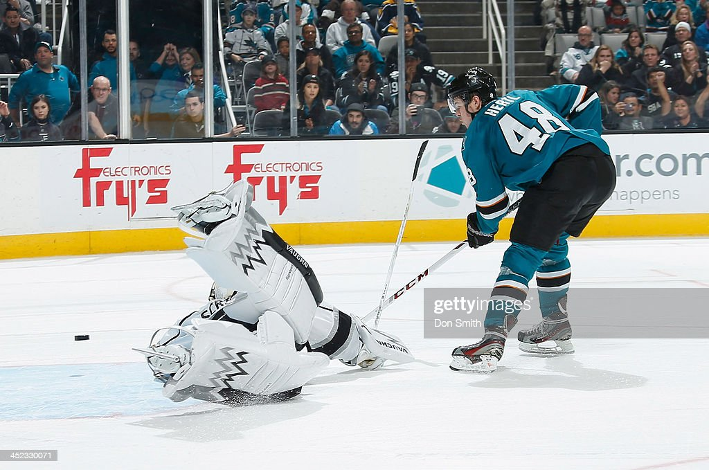 <a gi-track='captionPersonalityLinkClicked' href=/galleries/search?phrase=Tomas+Hertl&family=editorial&specificpeople=8761287 ng-click='$event.stopPropagation()'>Tomas Hertl</a> #48 of the San Jose Sharks gets the puck into the net in the shootout against <a gi-track='captionPersonalityLinkClicked' href=/galleries/search?phrase=Ben+Scrivens&family=editorial&specificpeople=7185205 ng-click='$event.stopPropagation()'>Ben Scrivens</a> #54 of the Los Angeles Kings during an NHL game on November 27, 2013 at SAP Center in San Jose, California.