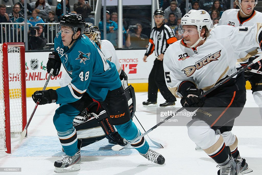 <a gi-track='captionPersonalityLinkClicked' href=/galleries/search?phrase=Tomas+Hertl&family=editorial&specificpeople=8761287 ng-click='$event.stopPropagation()'>Tomas Hertl</a> #48 of the San Jose Sharks goes for the puck after a missed shot against <a gi-track='captionPersonalityLinkClicked' href=/galleries/search?phrase=Sami+Vatanen&family=editorial&specificpeople=5894626 ng-click='$event.stopPropagation()'>Sami Vatanen</a> #45 of the Anaheim Ducks during an NHL game on November 30, 2013 at SAP Center in San Jose, California.