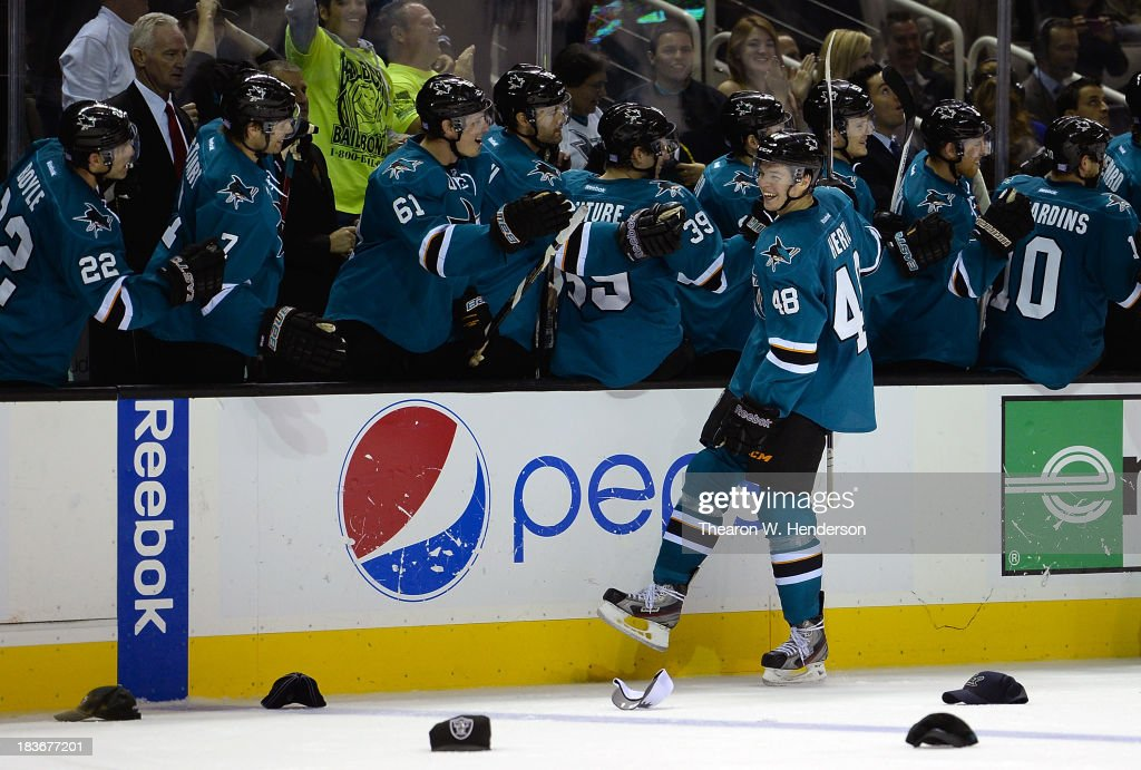 <a gi-track='captionPersonalityLinkClicked' href=/galleries/search?phrase=Tomas+Hertl&family=editorial&specificpeople=8761287 ng-click='$event.stopPropagation()'>Tomas Hertl</a> #48 of the San Jose Sharks is congratulated by teammates after he scored his third goal of the game against the New York Rangers during the third period at SAP Center on October 8, 2013 in San Jose, California. The Sharks won the game 9-2.