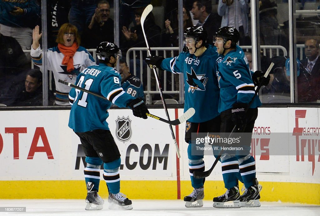 <a gi-track='captionPersonalityLinkClicked' href=/galleries/search?phrase=Tomas+Hertl&family=editorial&specificpeople=8761287 ng-click='$event.stopPropagation()'>Tomas Hertl</a> #48 of the San Jose Sharks is congratulated by <a gi-track='captionPersonalityLinkClicked' href=/galleries/search?phrase=Tyler+Kennedy&family=editorial&specificpeople=2119414 ng-click='$event.stopPropagation()'>Tyler Kennedy</a> #81 and <a gi-track='captionPersonalityLinkClicked' href=/galleries/search?phrase=Jason+Demers&family=editorial&specificpeople=2282534 ng-click='$event.stopPropagation()'>Jason Demers</a> #5 after he scored his fourth goal of the game against the New York Rangers during the third period at SAP Center on October 8, 2013 in San Jose, California. The Sharks won the game 9-2.