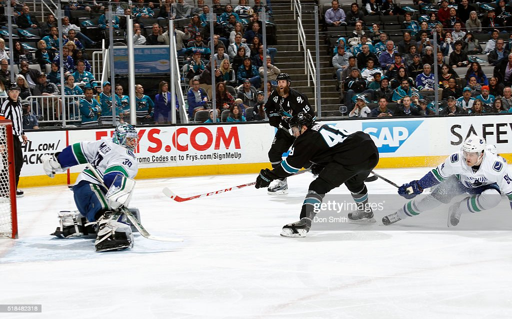 Tomas Hertl #48 of the San Jose Sharks reaches for a goal against Ryan Miller #30 of the Vancouver Canucks during a NHL game at the SAP Center at San Jose on March 31, 2016 in San Jose, California.