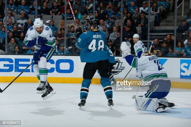 Tomas Hertl of the San Jose Sharks reacts and Erik Gudbranson of the Vancouver Canucks leaps in front of a shot against the Vancouver Canucks at SAP...