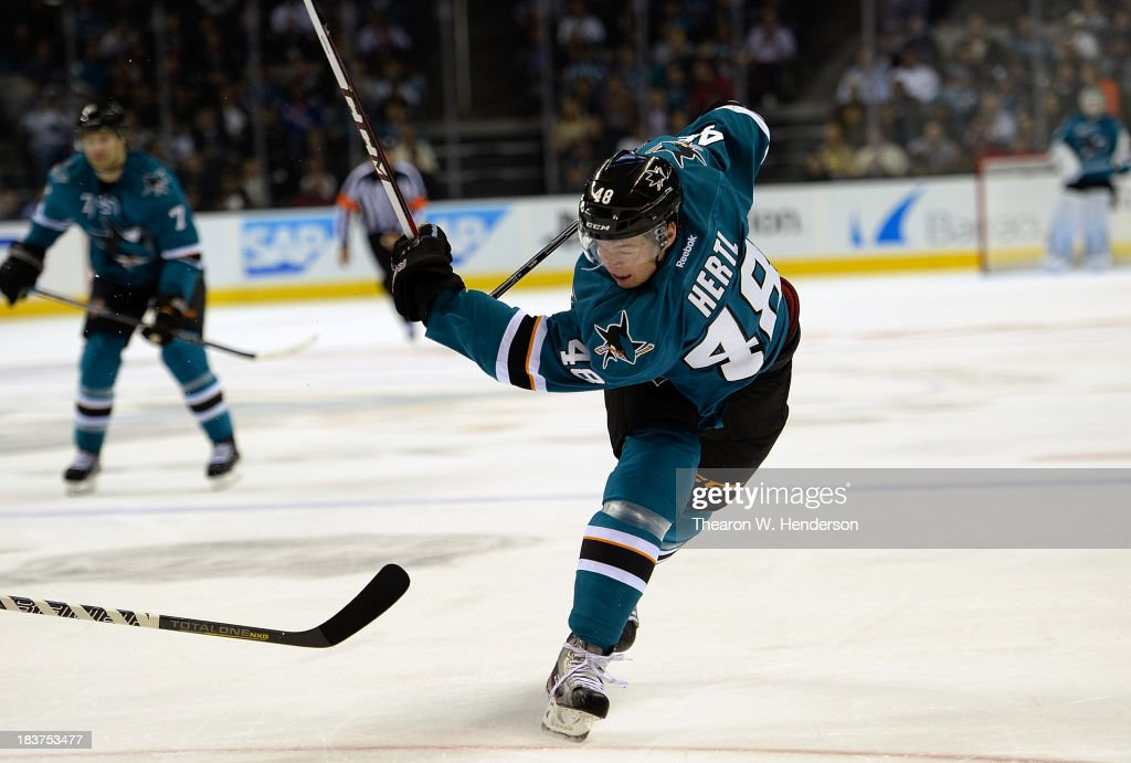 Tomas Hertl #48 of the San Jose Sharks shoots on goal and breaks his stick against the New York Rangers during the second period at SAP Center on October 8, 2013 in San Jose, California.