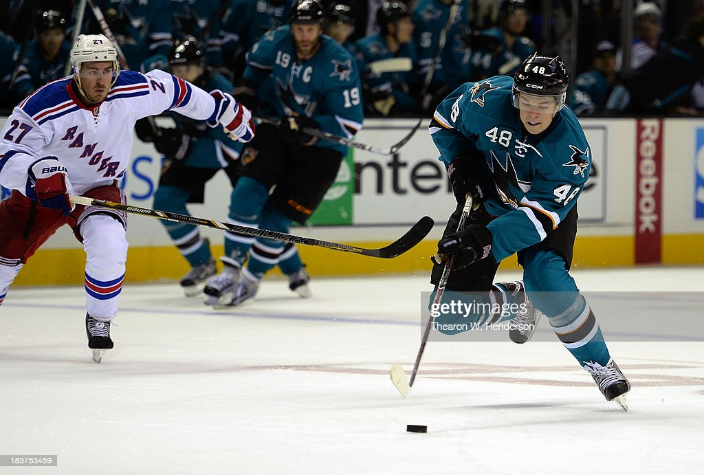 Tomas Hertl #48 of the San Jose Sharks skates with the puck on a breakaway against the New York Rangers during the second period at SAP Center on October 8, 2013 in San Jose, California.