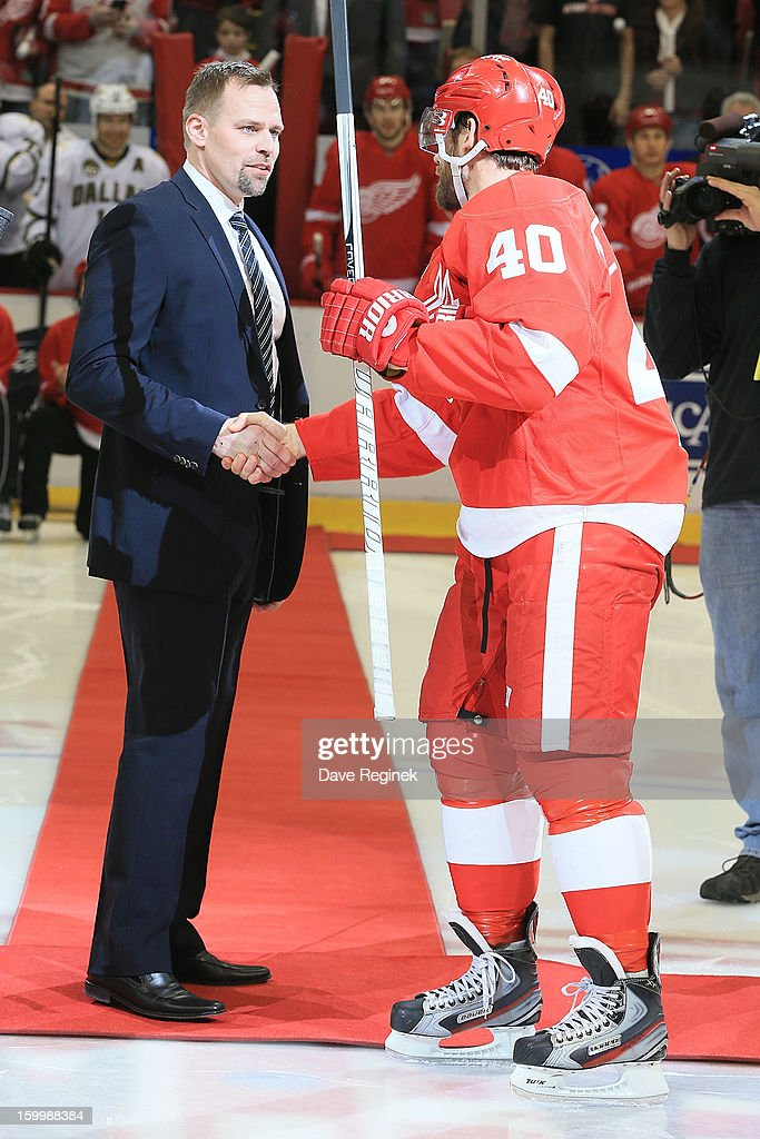 Tomas Holmstrom former Detroit Red Wing shakes hands with Henrik Zetterberg #40 during pre-game ceramonies before an NHL game against the Dallas Stars at Joe Louis Arena on January 22, 2013 in Detroit, Michigan. dallas won 2-1