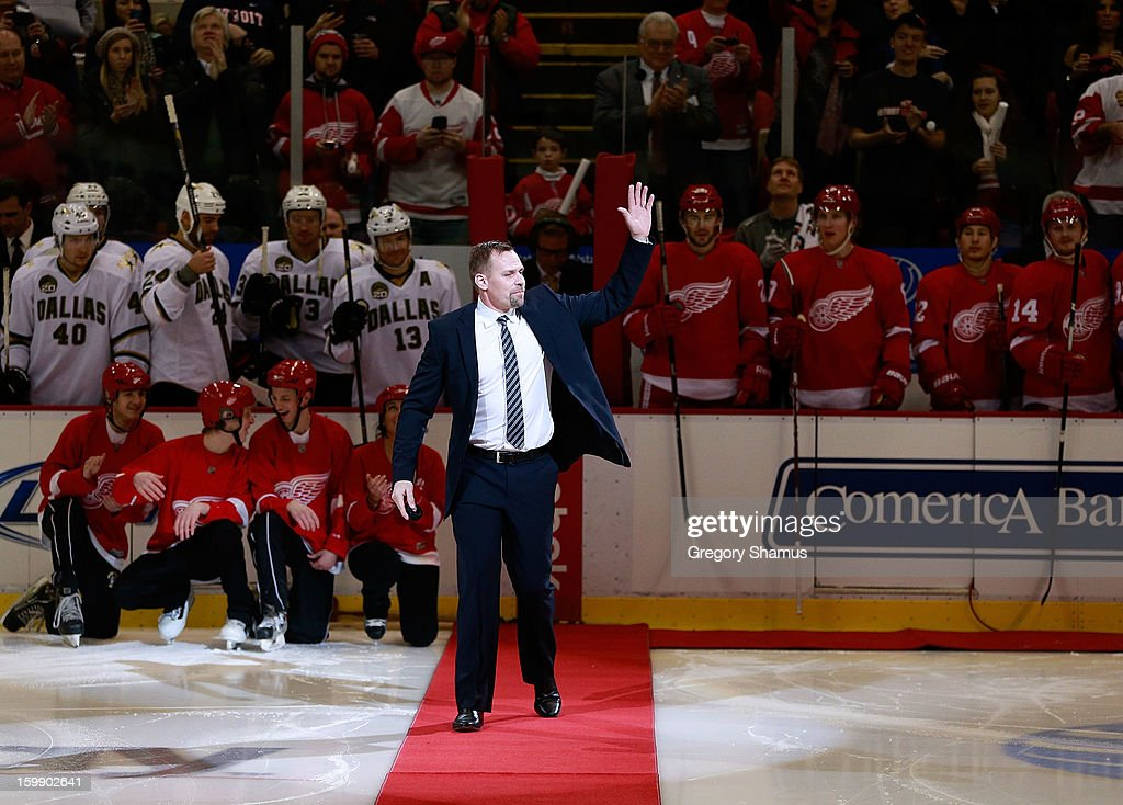 <a gi-track='captionPersonalityLinkClicked' href=/galleries/search?phrase=Tomas+Holmstrom&family=editorial&specificpeople=203288 ng-click='$event.stopPropagation()'>Tomas Holmstrom</a> high waves to fans as he heads out for a ceremonial puck drop after announcing his retirement from the NHL earlier in the day prior to the Detroit Red Wings playing the Dallas Stars at Joe Louis Arena on January 22, 2013 in Detroit, Michigan. Holmstrom played 15 years for the in the NHL all for the Detroit Red Wings.