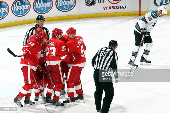 Tomas Holmstrom of the Detroit Red Wings celebrates his goal with teammates Johan Franzen Brad Stuart and Nicklas Lidstrom as Kent Huskins of the San...