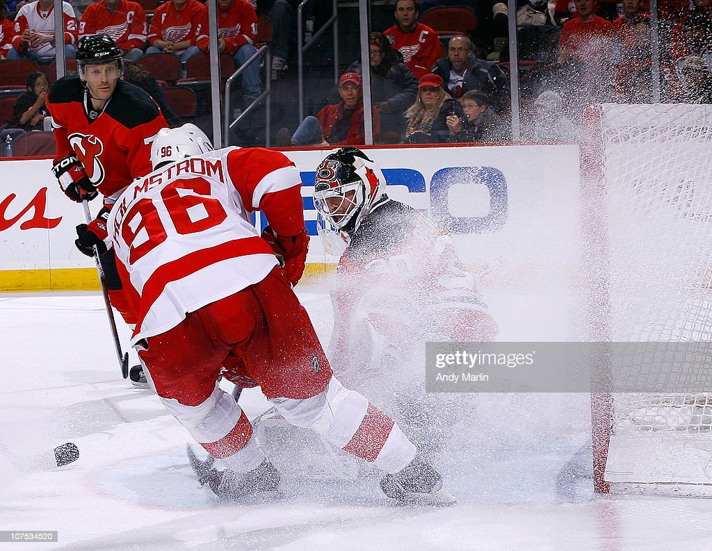 Tomas Holmstrom #96 of the Detroit Red Wings gives goaltender Martin Brodeur #30 of the New Jersey Devils a snow shower during the game at the Prudential Center on December 11, 2010 in Newark, New Jersey.