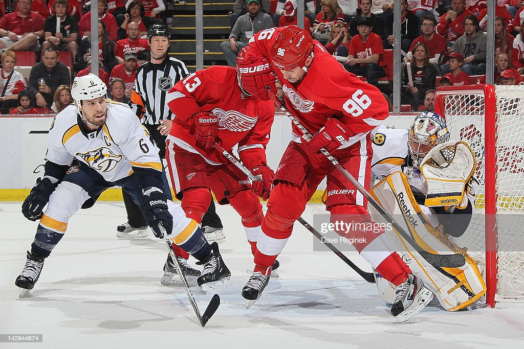 <a gi-track='captionPersonalityLinkClicked' href=/galleries/search?phrase=Tomas+Holmstrom&family=editorial&specificpeople=203288 ng-click='$event.stopPropagation()'>Tomas Holmstrom</a> #96 of the Detroit Red Wings jumps in the air screening <a gi-track='captionPersonalityLinkClicked' href=/galleries/search?phrase=Pekka+Rinne&family=editorial&specificpeople=2118342 ng-click='$event.stopPropagation()'>Pekka Rinne</a> #35 of the Nashville Predators as <a gi-track='captionPersonalityLinkClicked' href=/galleries/search?phrase=Shea+Weber&family=editorial&specificpeople=554412 ng-click='$event.stopPropagation()'>Shea Weber</a> #6 defends in Game Three of the Western Conference Quarterfinals during the 2012 NHL Stanley Cup Playoffs at Joe Louis Arena on April 15, 2012 in Detroit, Michigan. Nashville wins 3-2 leading the series 2-1.