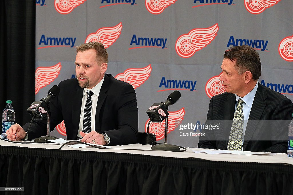 Tomas Holmstrom #96 of the Detroit Red Wings sits next to Executive Vice President & General Manager Ken Holland as he announces his retirement before the NHL home opening game against the Dallas Stars at Joe Louis Arena on January 22, 2013 in Detroit, Michigan. Dallas won 2-1
