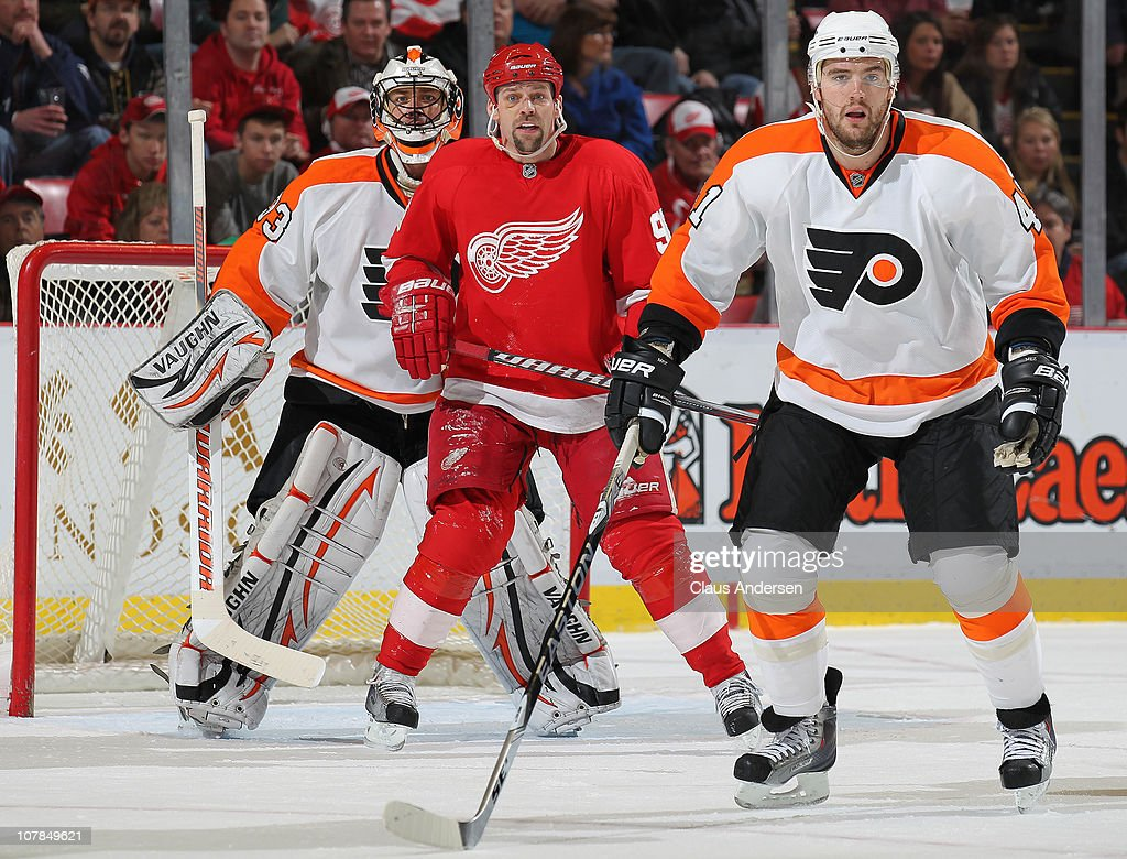 <a gi-track='captionPersonalityLinkClicked' href=/galleries/search?phrase=Tomas+Holmstrom&family=editorial&specificpeople=203288 ng-click='$event.stopPropagation()'>Tomas Holmstrom</a> #96 of the Detroit Red Wings waits to deflect an incoming shot between <a gi-track='captionPersonalityLinkClicked' href=/galleries/search?phrase=Brian+Boucher&family=editorial&specificpeople=179370 ng-click='$event.stopPropagation()'>Brian Boucher</a> #33 and <a gi-track='captionPersonalityLinkClicked' href=/galleries/search?phrase=Andrej+Meszaros&family=editorial&specificpeople=617818 ng-click='$event.stopPropagation()'>Andrej Meszaros</a> #41 of the Philadelphia Flyers in a game on January 2, 2011 at the Joe Louis Arena in Detroit, Michigan. The Flyers defeated the Wings 3-2.