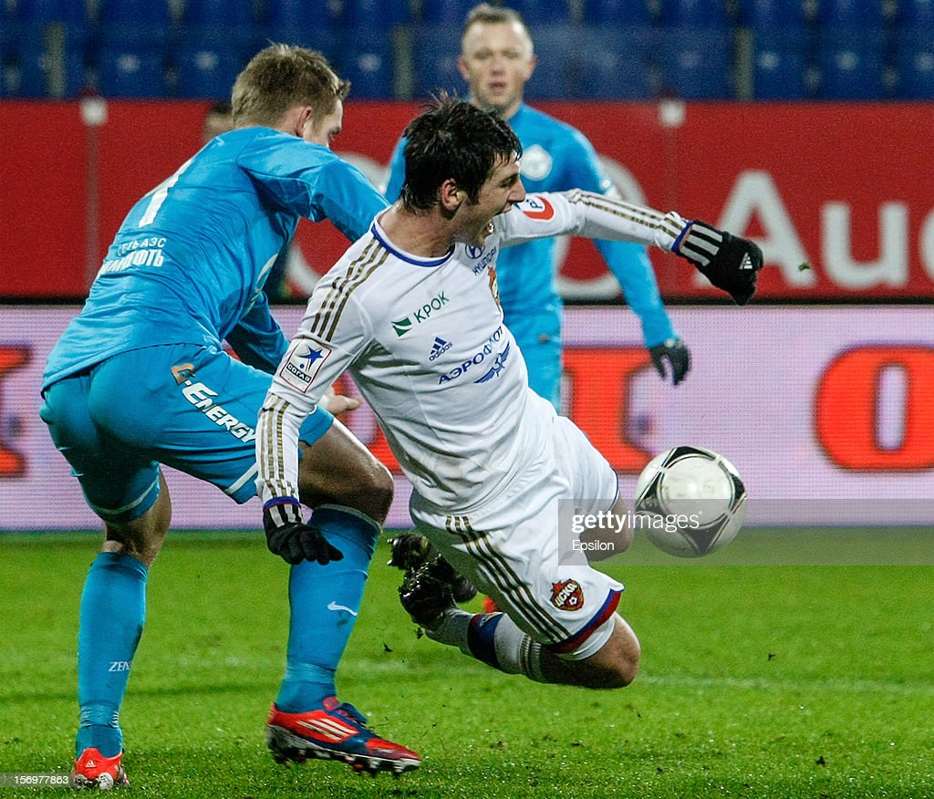 Tomas Hubocan of FC Zenit St. Petersburg (L) commits a foul on <a gi-track='captionPersonalityLinkClicked' href=/galleries/search?phrase=Alan+Dzagoev&family=editorial&specificpeople=5436464 ng-click='$event.stopPropagation()'>Alan Dzagoev</a> of PFC CSKA Moscow in the penalty area during the Russian Football League Championship match between FC Zenit St. Petersburg and PFC CSKA Moscow at the Petrovsky Stadium on November 26, 2012 in St. Petersburg, Russia.