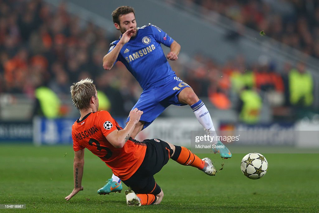 Tomas Hubschman (L) of Shakhtar Donetsk tackles Juan Mata (R) of Chelsea during the UEFA Champions League Group E match between Shakhtar Donetsk and Chelsea at the Donbass Arena on October 23, 2012 in Donetsk, Ukraine.
