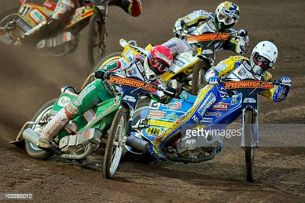 Tomas Jonasson from Sweden and Tomasz Gollob of Poland compete during the FIM Speedway Grand Prix of Sweden at the speedway stadium in Malilla on...