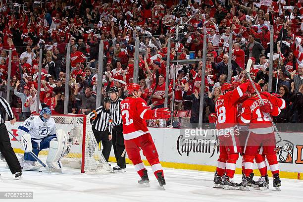 Tomas Jurco Justin Abdelkader Marek Zidlicky and Brendan Smith of the Detroit Red Wings congratulate teammate Joakim Andersson after scoring a goal...