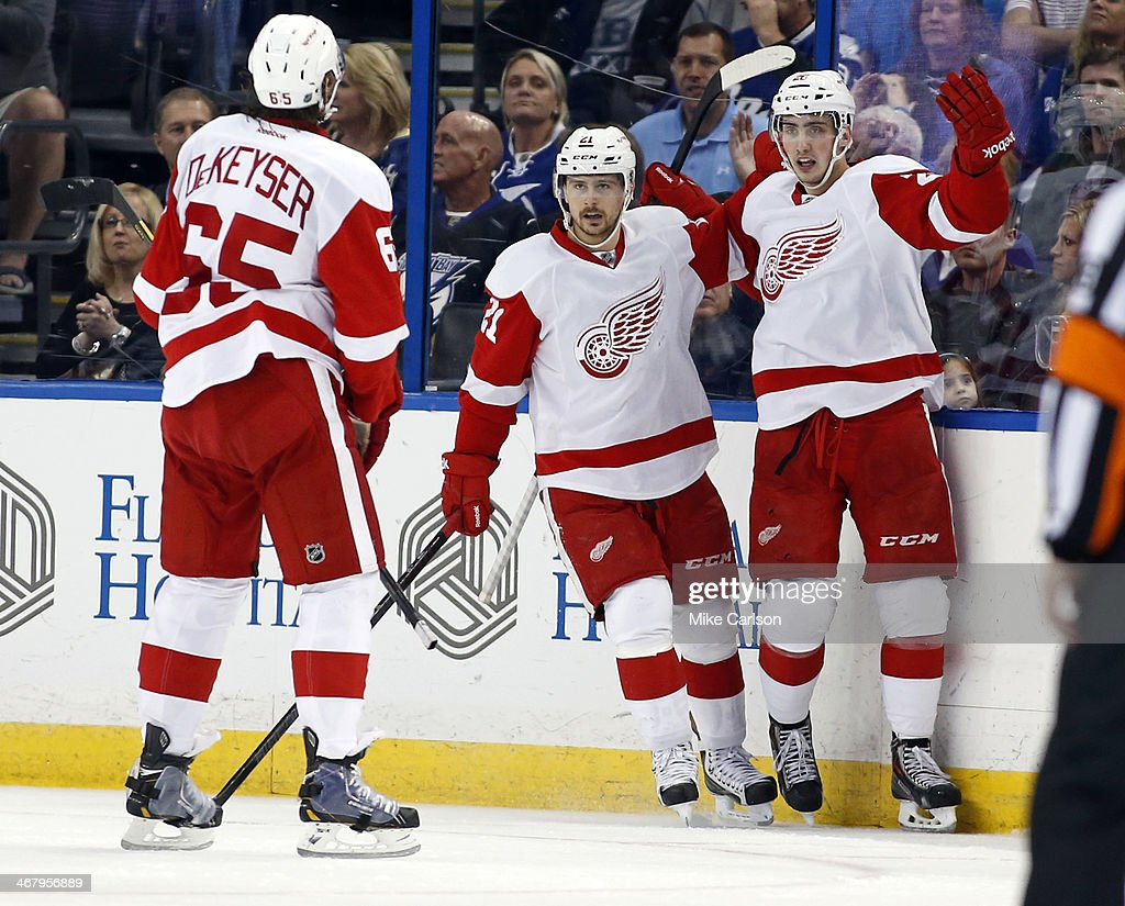 Tomas Jurco #26 of the Detroit Red Wings celebrates a goal with <a gi-track='captionPersonalityLinkClicked' href=/galleries/search?phrase=Tomas+Tatar&family=editorial&specificpeople=5652303 ng-click='$event.stopPropagation()'>Tomas Tatar</a> #21 and Danny DeKeyser #65 against the Tampa Bay Lightning at the Tampa Bay Times Forum on February 8, 2014 in Tampa, Florida.