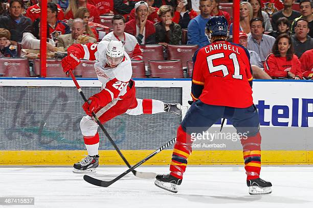 Tomas Jurco of the Detroit Red Wings shoots the puck at the net past Brian Campbell of the Florida Panthers at the BBT Center on February 6 2014 in...