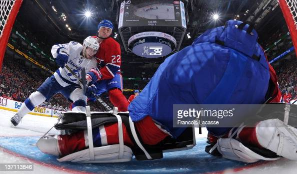 Tomas Kaberle of the Montreal Canadiens battles for position in front of the net with Tom Pyatt the Tampa Bay Lightning during the NHL game on...